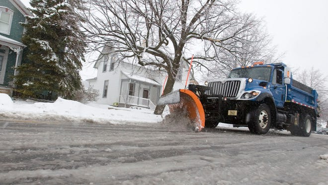A city snow plow clears North Sixth Street near Pennsylvania Avenue in Sheboygan Wednesday March 9, 2011 after snow covered the county. Photo by Bruce Halmo/The Sheboygan Press