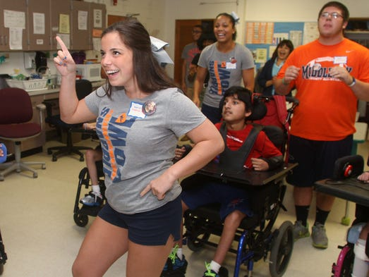 Snapple Bowl cheerleader Sara Bozzomo of Middlesex dances to a Michael Jackson song during the team's visit to the Lakeview School, Monday, July 14, 2014, in Edison, NJ.  Photo by Jason Towlen