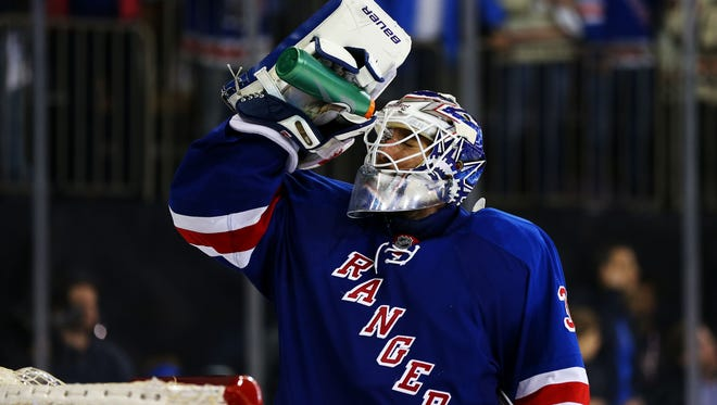 New York Rangers goalie Henrik Lundqvist takes a water break in the third period on Game 6.