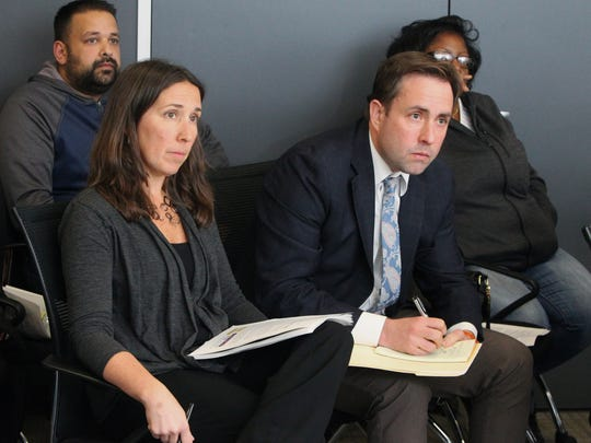 Jennifer Givner, New York State Thruway Authority director of media relations, and Adam Wood, Chief of Staff, listen during a panel discussion of cashless tolling issues on the Gov. Mario Cuomo Bridge at The Journal News in White Plains Jan. 9, 2018.