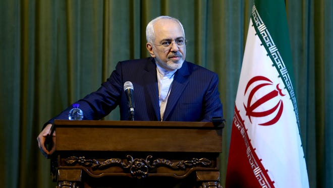 Iranian Foreign Minister Mohammad Javad Zarif listens to a question during a press conference with his German counterpart Frank-Walter Steinmeier in Tehran, Iran, on Oct. 17, 2015.