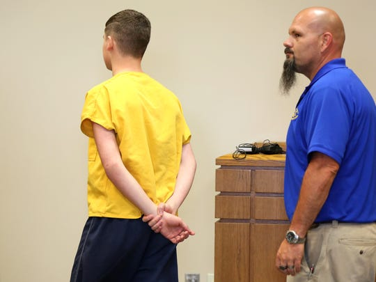 "James ""Austin"" Hancock, 15, leaves the courtroom after his sentencing for the school shooting in Madison Township."