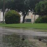 Rain prompts flood watch in Lee County