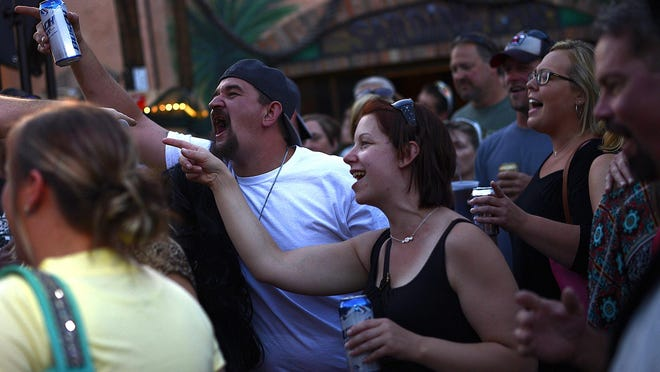 The crowd cheers as the band Crankin' Yankees plays the Sardine Can tiki bar on a recent Wednesday night.