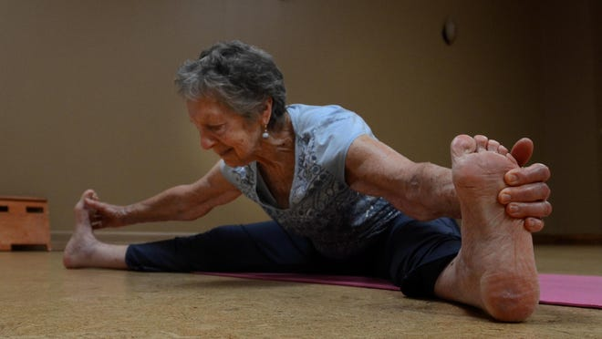 Mimi Holland-Moritz show her flexibility while taking a quick break from teaching a yoga class at Northville Square on June 6. The 90 year-old has been doing and teaching yoga for 25 years since she retired from the Walled Lake School District.