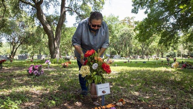 "Brenda Ramos cries over the grave of her son, Michael Ramos, on June 9. An Austin police officer shot and killed her 42-year-old son on April 24. ""I still think he's here sometimes because I catch myself looking out the window. He's coming,"" Brenda Ramos says. ""And I have to tell myself he's not here."""
