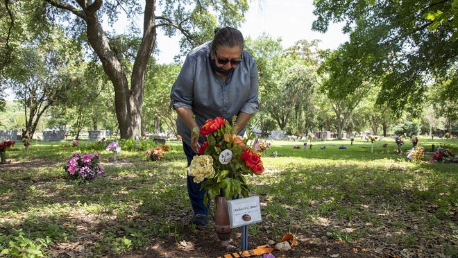 Brenda Ramos cries over the grave of her son, Michael Ramos, on June 9.  In response to the police killings of Michael Ramos and others, there is a growing movement to reduce the size of the police presence in cities, Octavio Martinez Jr. writes.