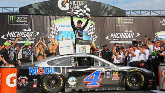 Kevin Harvick celebrates after winning the Consumers Energy 400 at Michigan International Speedway in 2019.