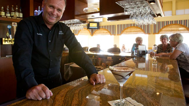 Olde Hickory Golf & Country Club bartender Tommy Lang shows off his famous ice cream-based Brandy Alexander.