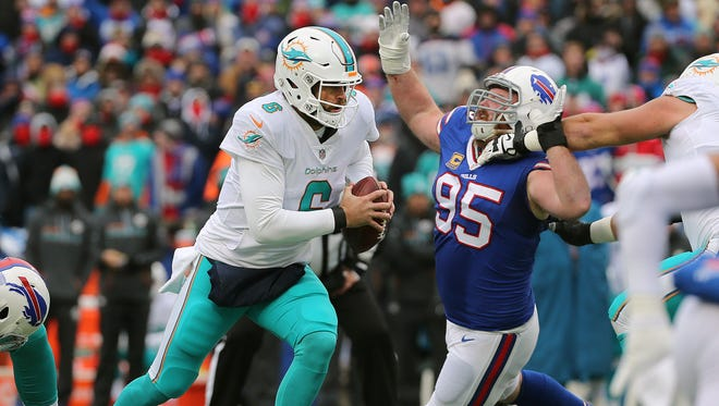 Dolphins quarterback Jay Cutler is pressured by Bills defensive tackle Kyle Williams.  Cutler was sacked three times and threw three interceptions as the Bills went on to win 24-16.