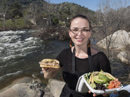 Allison Millner and her husband Dane Millner own Sierra Subs & Salads in Three Rivers. The restaurant was recently distinguished by Yelp as one of the top 100 places to eat in the United States and has tables that overlook the Kaweah River. The Muffuletta, left, and the Avocado Veggie Salad are among more than 35 offerings including burgers, hotdogs and pizza