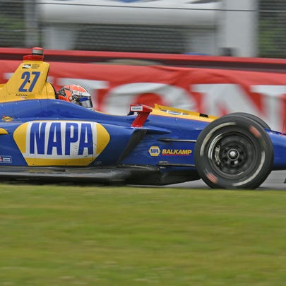Alexander Rossi speeds through the Carrousel turn at