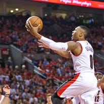 Apr 27, 2015; Portland, OR, USA; Portland Trail Blazers guard Damian Lillard (0) shoots against the Memphis Grizzlies during the second quarter in game four of the first round of the NBA Playoffs at the Moda Center. Mandatory Credit: Craig Mitchelldyer-USA TODAY Sports