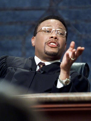 "Television Judge Greg Mathis presides over court during the taping of his show ""Judge Mathis"" in 2001, in Chicago. A Springfield couple will appear on the show in November following allegations they faked a death to avoid paying back borrowed money."