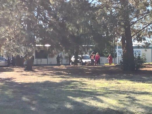 People linger near Rancho Tehama Elementary School
