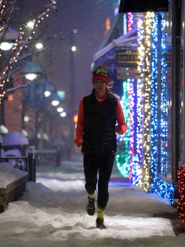 Tina Myers runs through downtown Rochester Wednesday