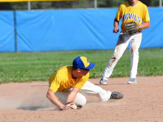 Zach Bruce knocks down a line drive at third base in