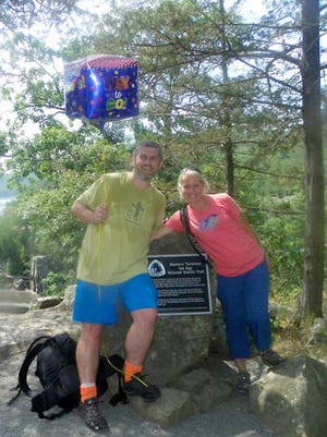 Sean Quinn and Kassie Kolden completed hiking the length of the Ice Age Trail over an 18 month span. The pair completed the hike on August 4, 2014.