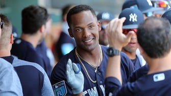 New York Yankees third baseman Miguel Andujar (67) is congratulated in the dugout after hitting a home run during the second inning against the Philadelphia Phillies at Spectrum Field.