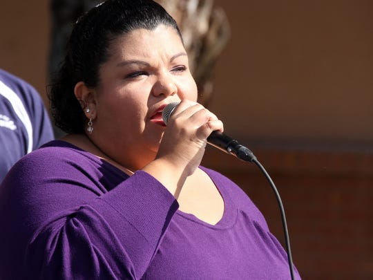 """Joanna Costilla sang """"The Star-Spangled Banner"""" and """"God Bless American"""" during Saturday's Veterans Day ceremony."""