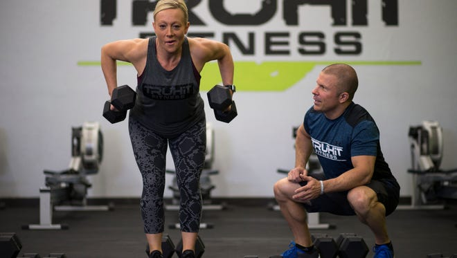 Scott Van Horne works with Michele Dryden on May 4, 2017, at TruHIT Fitness in Scottsdale. Michele has lost 55 pounds since training at TruHIT Fitness.