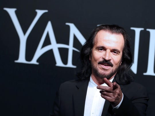 Greek musician Yanni poses for a photo before a press
