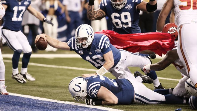 """Andrew """"Superman"""" Luck dives into the endzone to give the Colts hope."""