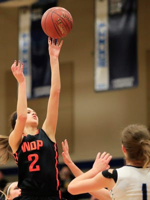 West De Pere's Sam Carriveau (2) shoots over Bay Port defenders during a nonconference girls basketball game Friday in Suamico. The Phantoms picked up the win to improve to 9-0 this season.