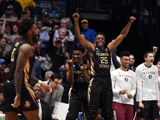 Florida State Seminoles forward Mfiondu Kabengele (25) celebrates after defeating the Xavier Musketeers in the second round of the 2018 NCAA Tournament at Bridgestone Arena.