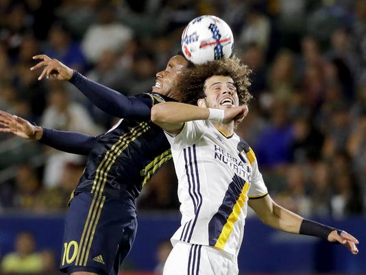 Philadelphia Union midfielder Roland Alberg, left, heads the ball away from LA Galaxy midfielder Joao Pedro during the first half of an MLS soccer match in Carson, Calif., Saturday, April 29, 2017. (AP Photo/Chris Carlson)