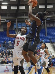 Red River's Makayia Hallmon (3, right) shoots over