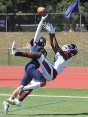 Aidan Bilali of Old Tappan breaks up a pass in the end zone meant for Charles Njoku of Wayne Hills.