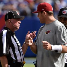 Arizona Cardinals quarterback Carson Palmer (right) talks with officials during the game against the New York Giants at MetLife Stadium.