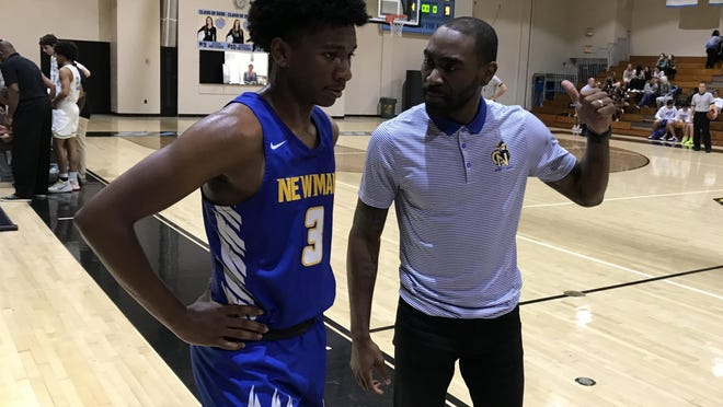 Cardinal Newman coach Tavarus Harris, right, talks to junior Nick Tingling (3) during Thursday night's road game at St. John Paul II Academy in Boca Raton. Tingling had 11 points, helping Newman to a 65-59 win.