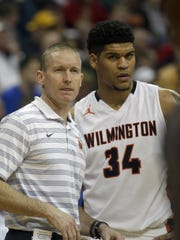 Wilmington head coach Mike Noszka (left) with Jarron Cumberland during the Hurricane's state semifinal against Lima Senior.