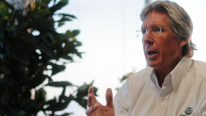 CSU Athletic Director Jack Graham speaks with Coloradoan reporter Kelly Lyell in 2012.  Graham was fired as the school's athletic director on Friday.