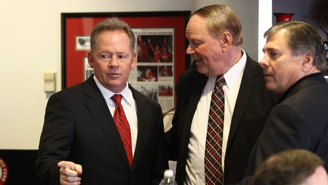 Bobby Petrino, James Ramsey and Tom Jurich talk before the press conference.  Jan 9, 2014