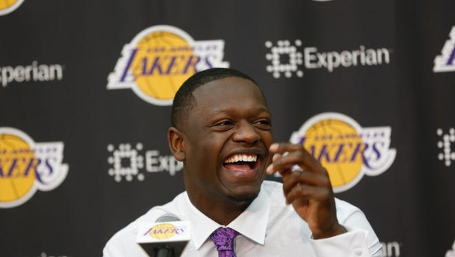 Former Kentucky forward Julius Randle smiles as he is introduced as the newest Los Angeles Laker by General Manager Mitch Kupchak, not seen, Monday, June 30, 2014 in El Segundo, Calif.Former Kentucky forward Julius Randle was selected seventh overall by the Lakers during the 2014 NBA draft. (AP Photo/Damian Dovarganes)