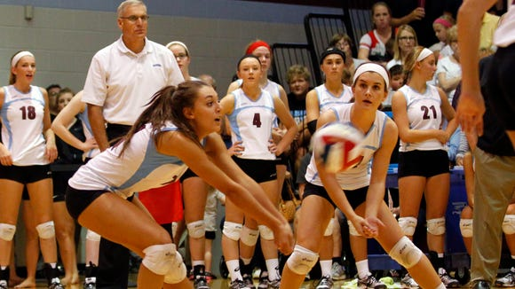 Assumption High School's Kenzie Maloney (11) makes the play against Mercy Academy during their volleyball matches at Assumption High School in Louisville, Kentucky.       September 8, 2014