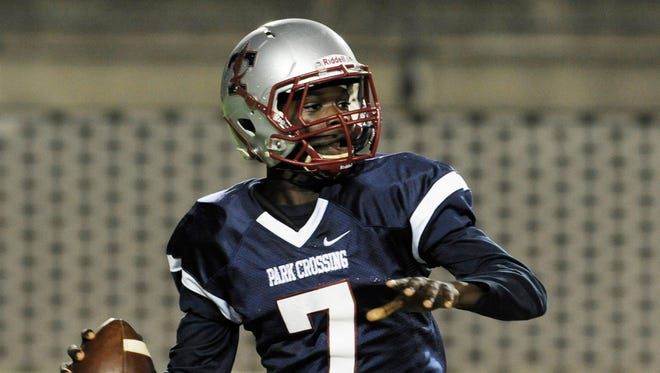 Park Crossing quarterback Micale Cunningham (7) looks to throw against Northview at Cramton Bowl in Montgomery, Ala. on Friday October 3, 2014.
