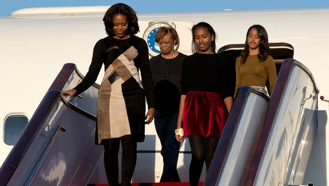 First Lady Michelle Obama with her mother Marian Robinson, daughters Sasha Obama and Malia Obama arrives at Beijing Capital International Airport on March 20, 2014 in Beijing, China.