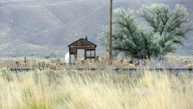 Train tracks run in front of an old cabin in Carlin, Nev., in this file photo.