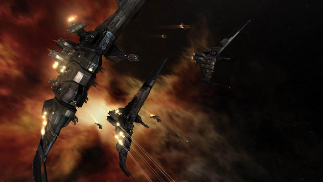 "This undated publicity file image provided by CCP Games shows a screenshot from the game ""EVE Online."" An unpaid bill in the online role-playing game ""EVE Online"" has led to a virtual space battle involving thousands of players with costly losses in real-world money. The siege on Monday, Jan. 27, marks the bloodiest battle in the game's 10-year history."
