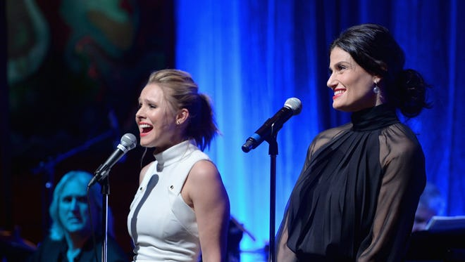 """Kristen Bell, left, and Idina Menzel sign the  music of Disney's """"Frozen"""" at Los Angeles Vibrato Grill Jazz club Sunday night."""