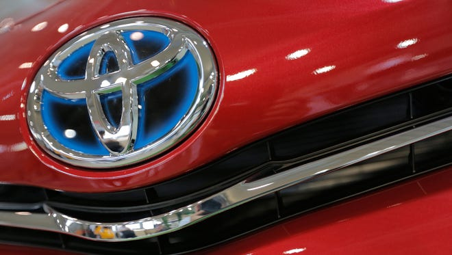 The emblem of a Toyota car shines at Toyota Motor Corp.'s showroom Toyota Mega Web in Tokyo.