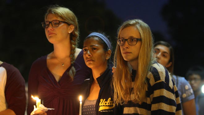 Students of UCSB and UCLA mourn at a candlelight vigil at UCLA for the victims of a recent killing rampage.