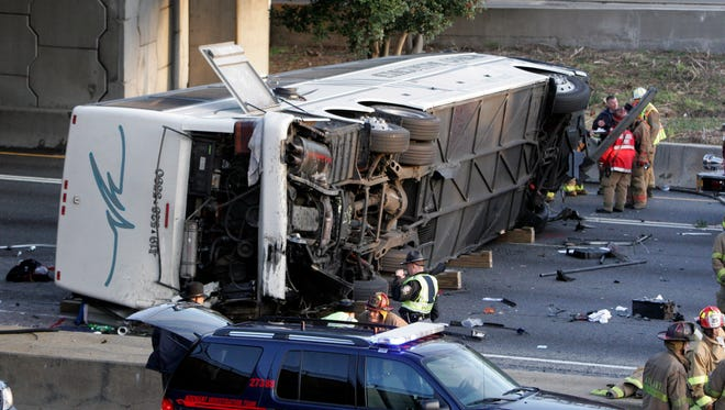 This March 2, 2007, photo shows a charter bus carrying the Bluffton University baseball team from Ohio after it plunged off a highway ramp early in Atlanta and slammed into the I-75 pavement below.