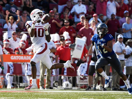 Arkansas receiver Jordan Jones makes a touchdown catch in front of Eastern Illinois defender Dylan Smith in the first half of an NCAA college football game Saturday, Sept. 1, 2018, in Fayetteville, Ark. (AP Photo/Michael Woods)