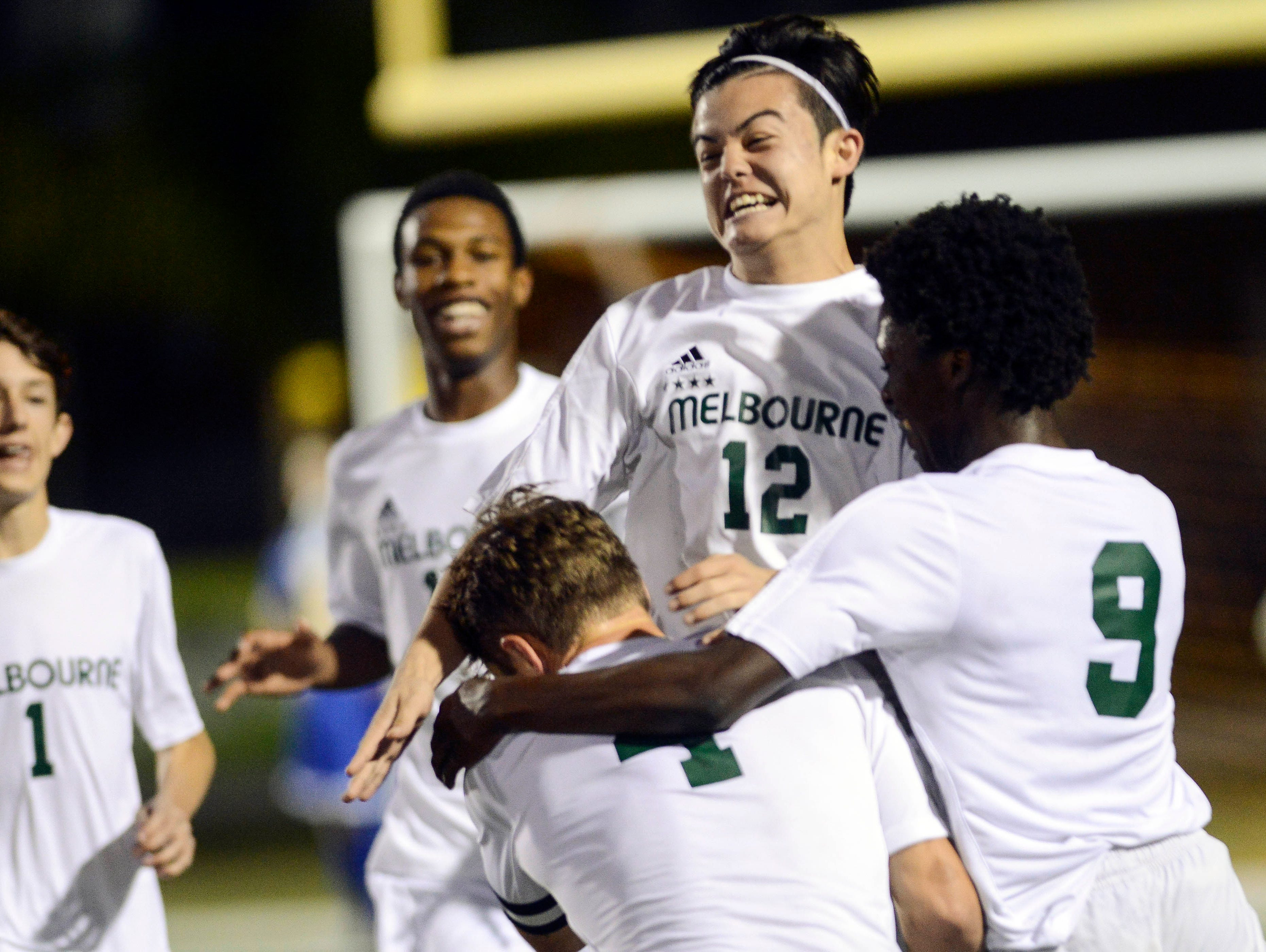 Melbourne players celebrate a goal in the District 6-4A tournament.