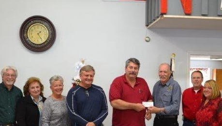 The Northeast Lakeside F.D. Auxiliary presented a check for $7,500 to the N.E.L.F.Association  for a total of $15,000 for the year 2015. Pictured from left are board members Eddie Danhauer, Vallene Danhauer, Pam Hargrave, Terry Buchman, Fire Captain Rick Williamson, board members Hart Rowland, Tom Telford and Kathy Guisinger.